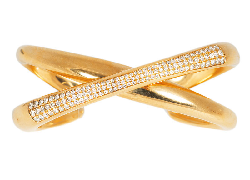 A highcarat golden bangle bracelet with diamonds