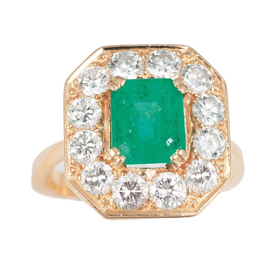 A ring with diamonds and one green glass stones
