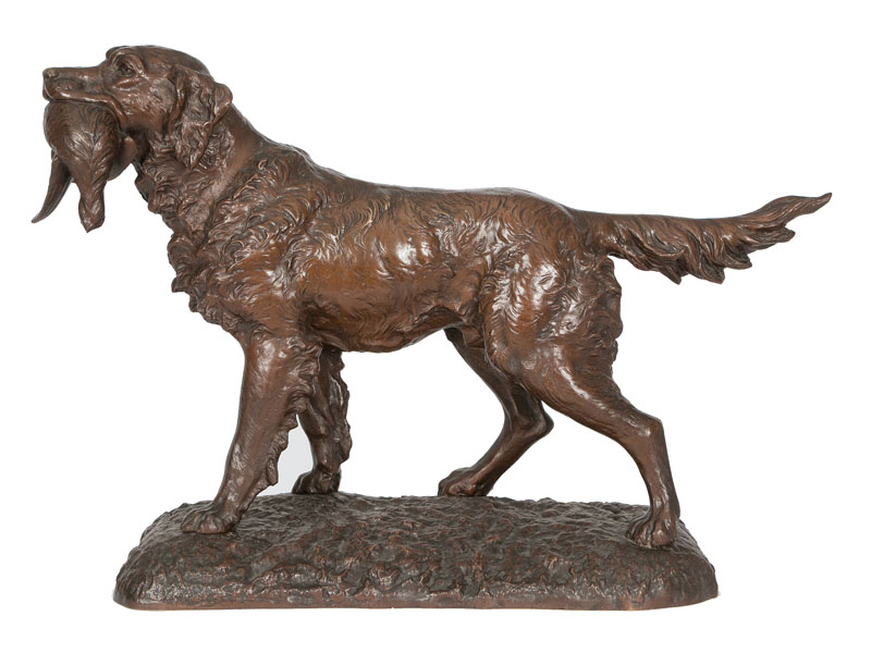 A bronze sculpture 'Pointer holding a pheasant'