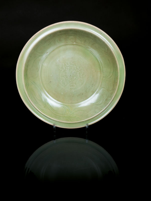 A large celadon plate with floral ornament