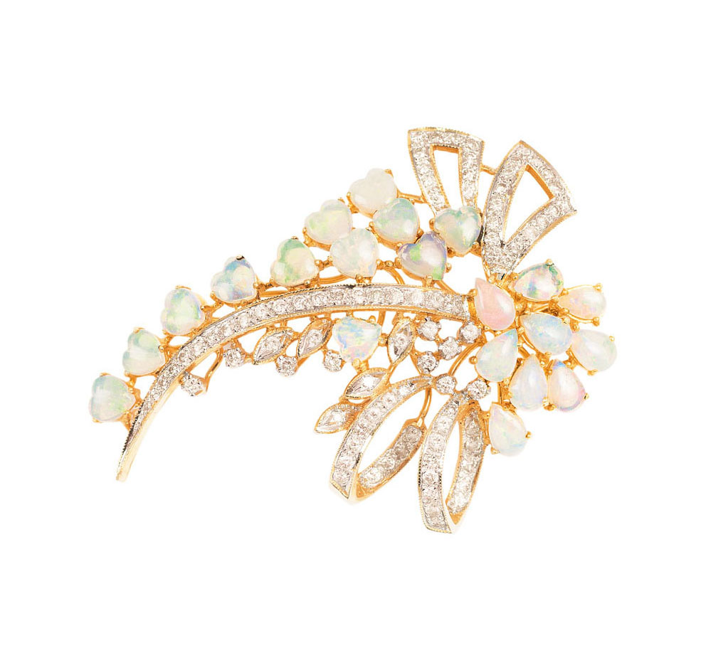 An opal diamond brooch with matching pendant