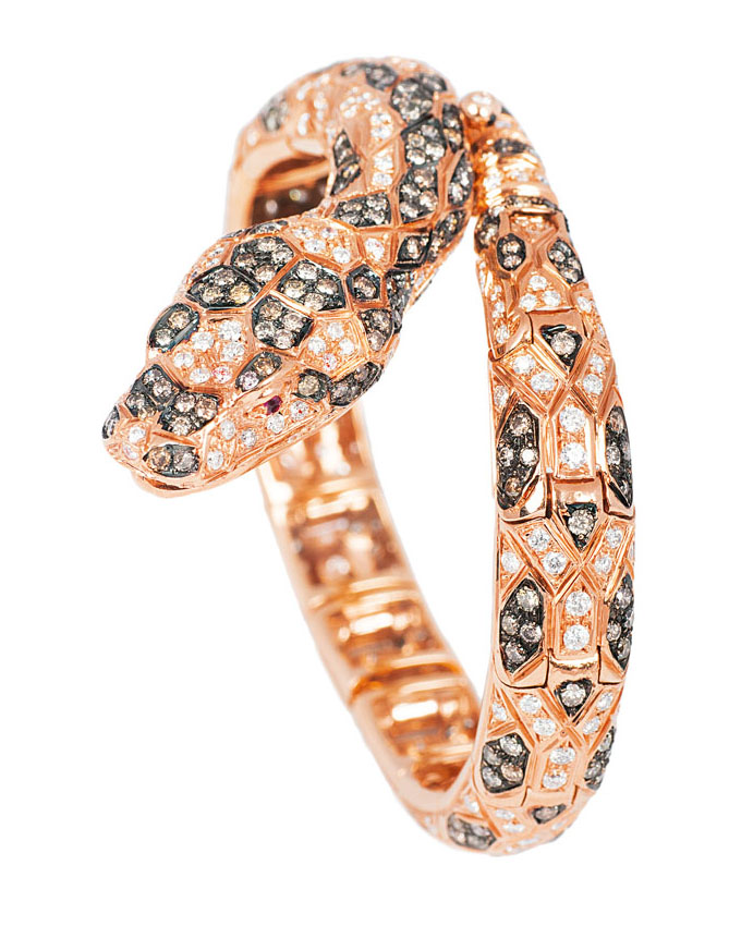 An extraordinary golden bracelet 'Snake' with two-coloured diamonds