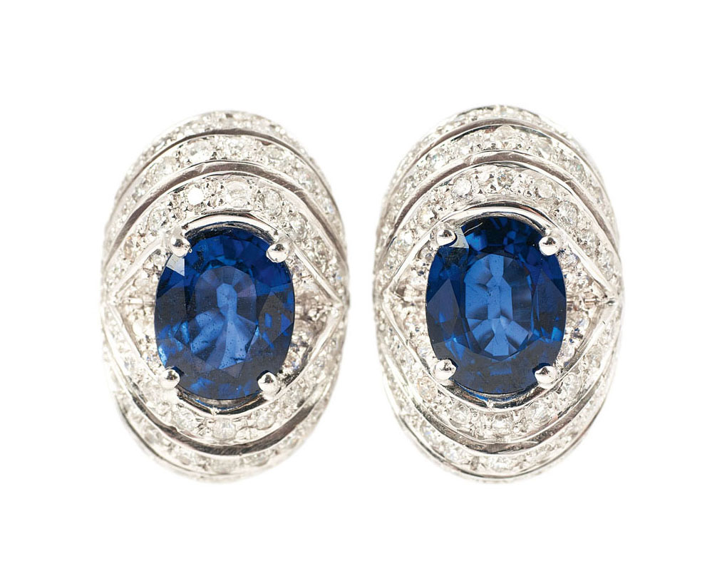 A pair of sapphire diamond earrings