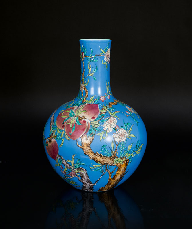 An exceptional blue ground vase with 9 peaches