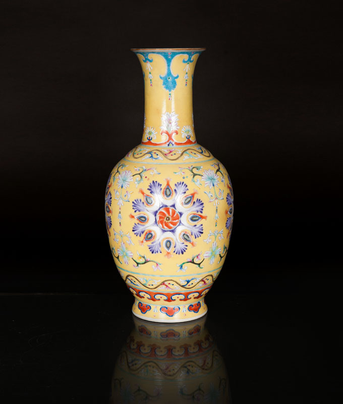 A yellow ground vase with ornaments