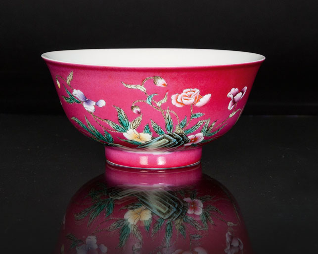 A ruby ground bowl with flowers