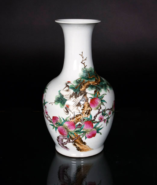 A baluster vase with symbols of longevity