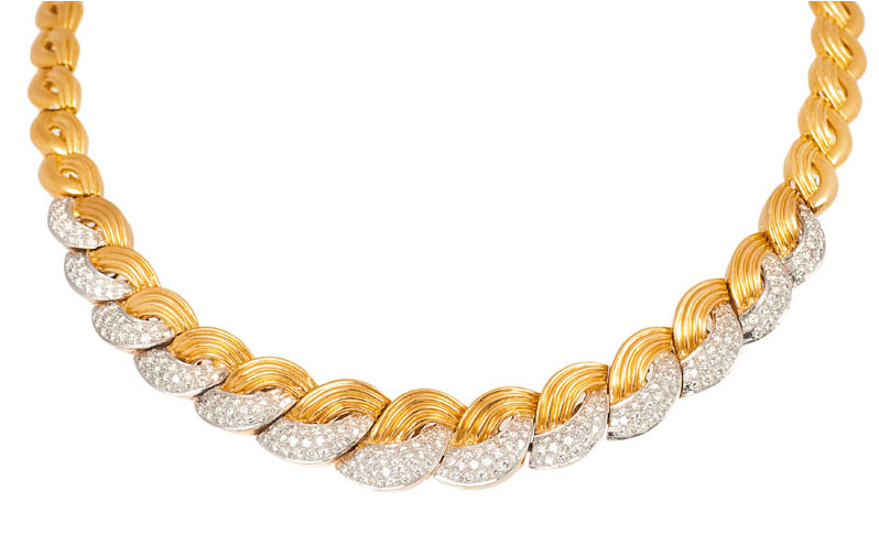 A gold diamond demiparure with necklace and bracelet
