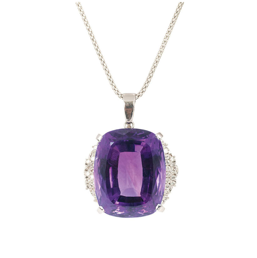A large amethyst diamond pendant with necklace