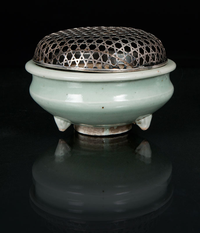 A celadon tripod censer with silver cover