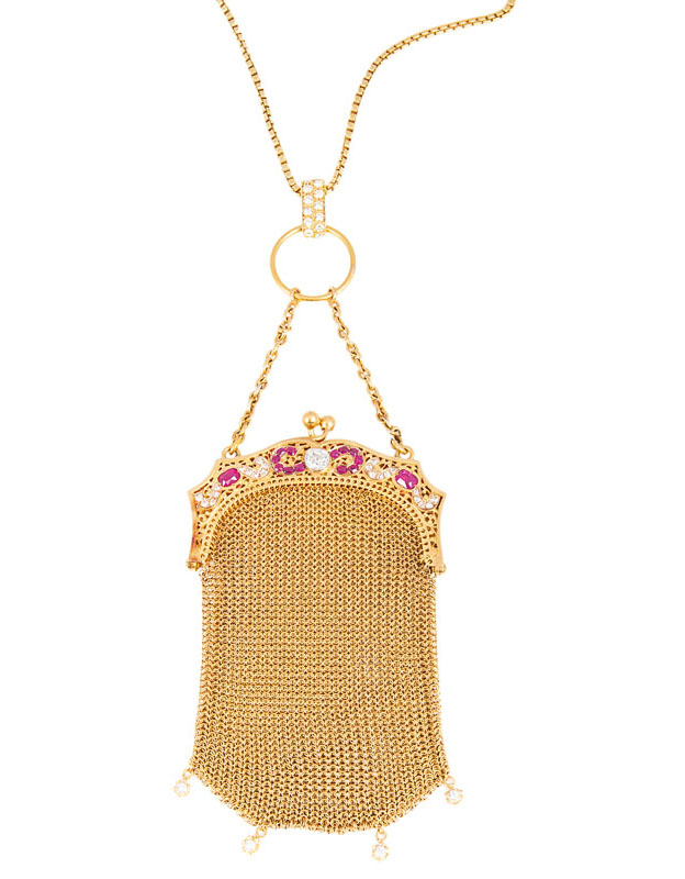 A small Art Nouveau golden evening purse with rubies and diamonds