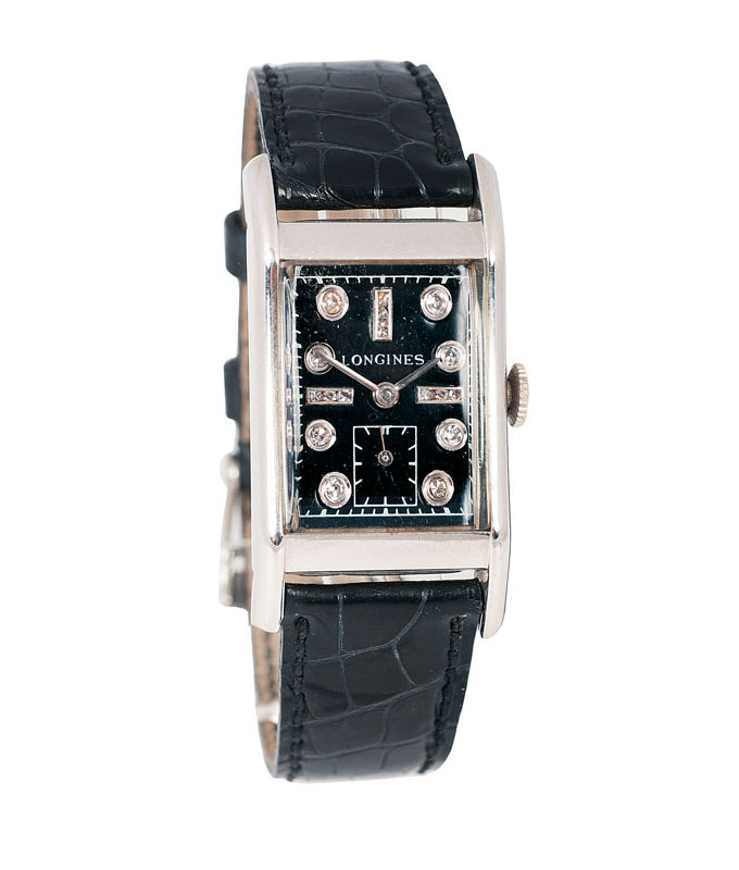A gentlemen's wrist watch with diamonds by Longines
