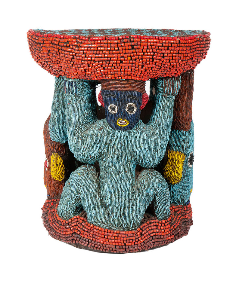 An african stool with beads