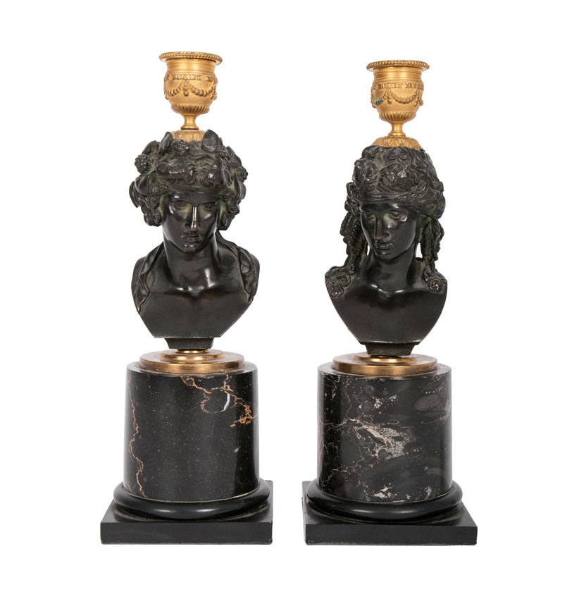 A pair of bronze bustes as candlestick