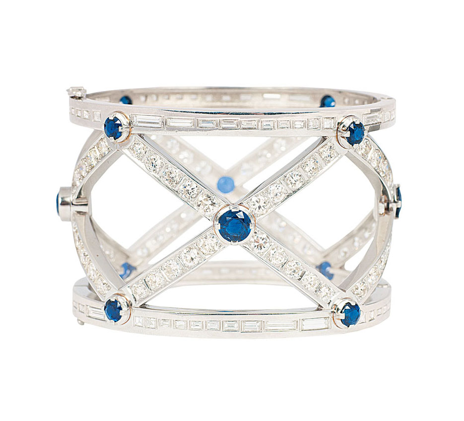 An extraordinary platinum bangle bracelet with diamonds and sapphires