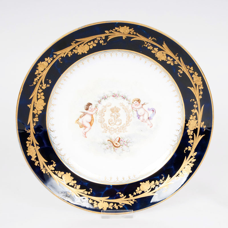 A Sèvres plate decorated with 'Putti'