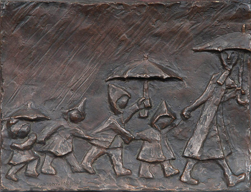 A bronze relief 'Walk in the rain'