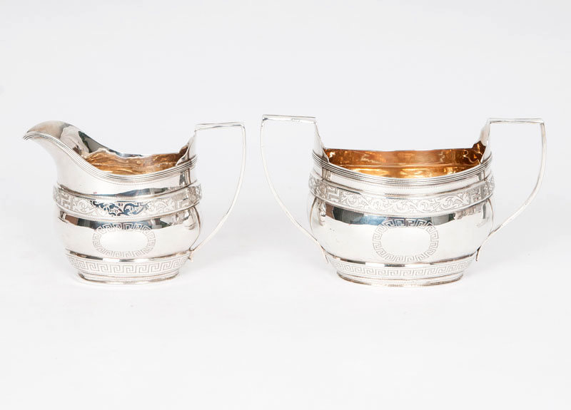 A set of creamer and sugar bowl with classical engraved pattern
