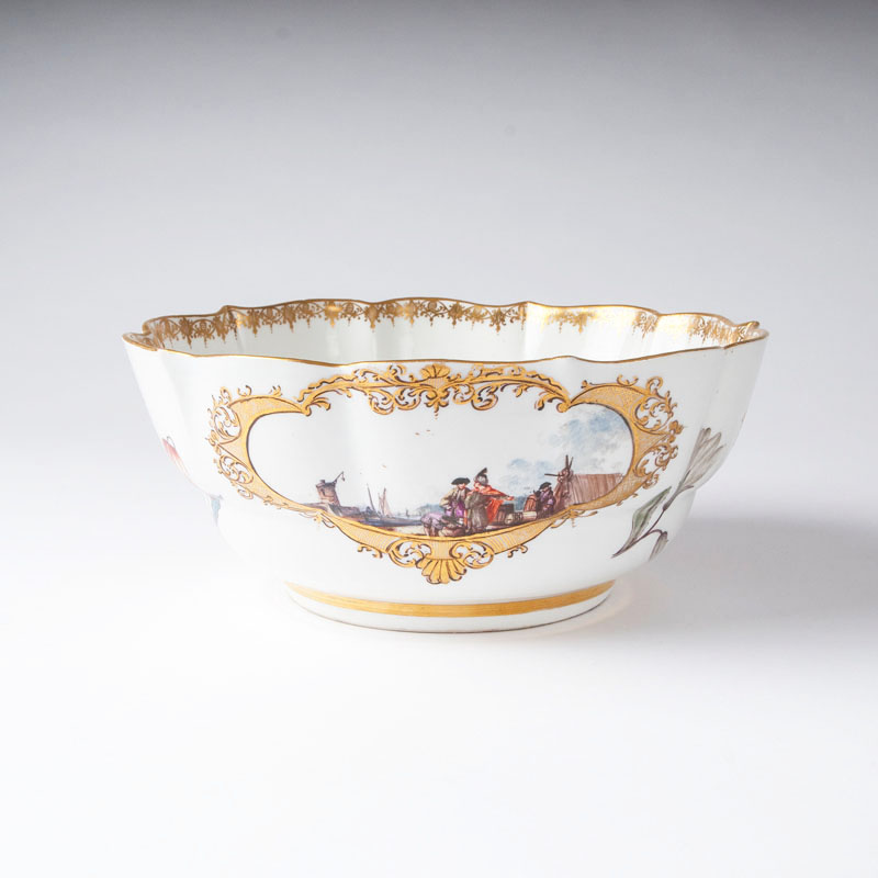A large bowl with oriental port scenes and botanic flowers