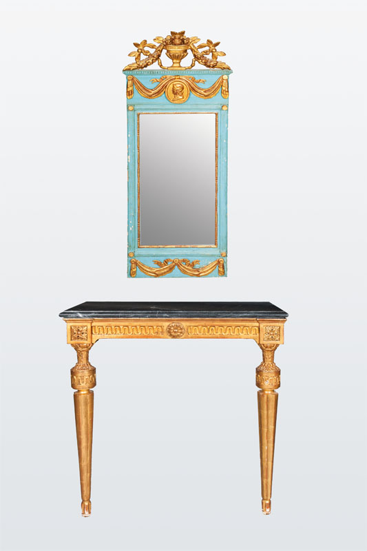 A classizistical mirror with console table