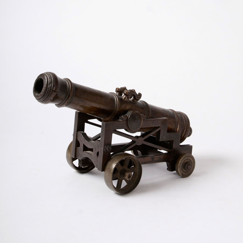 A miniature ship cannon on a bronze carriage