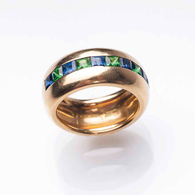 A ring with sapphires and tsavoriths by Jeweller Hansen