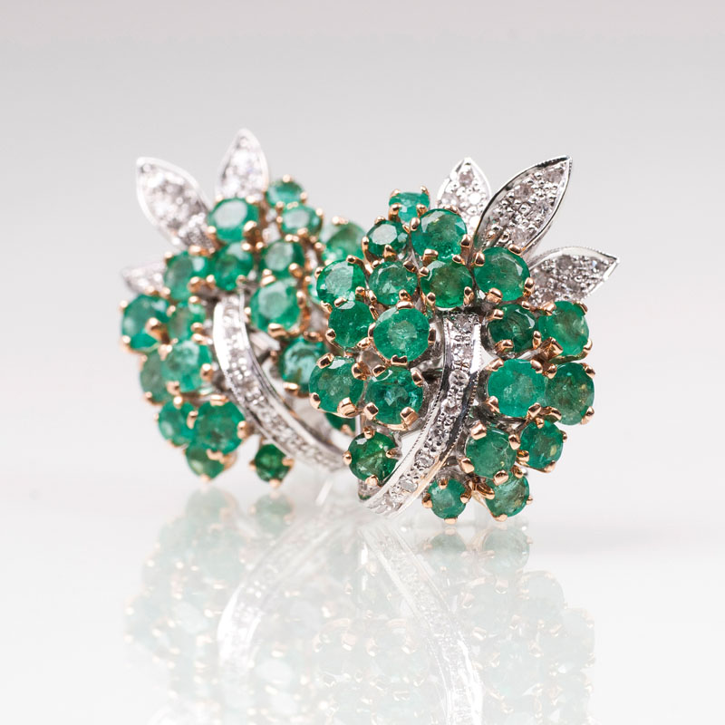 A pair of emerald diamond earrings