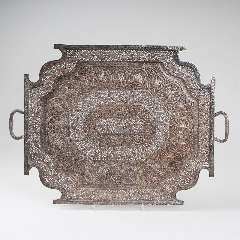 A decorative serving tray with rich openwork