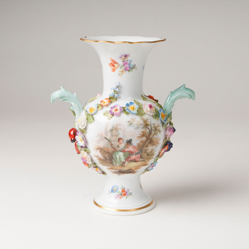 A small vase with Watteau-scene and sculptural flowers