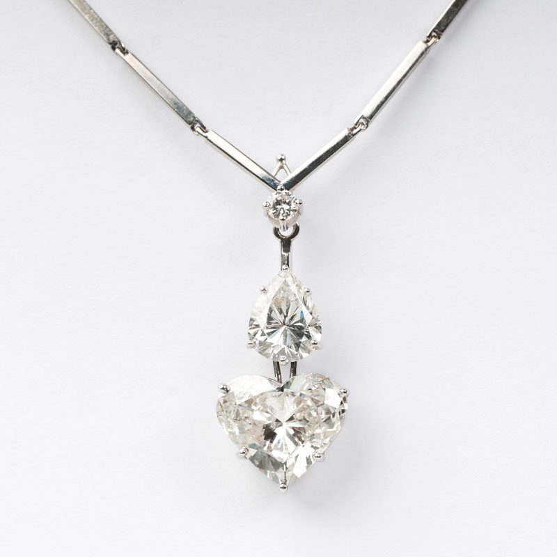 A rare, exquisite and highcarat pendant with fine heart and pear shape diamonds