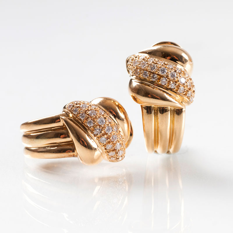 A pair of ear clips with diamonds