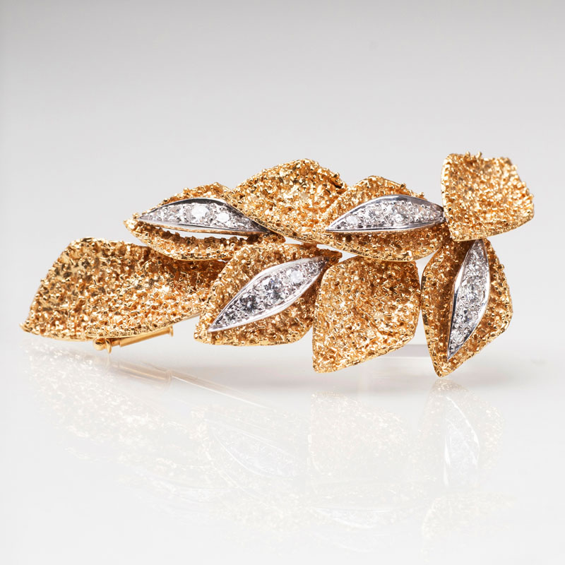 A goldenvintage  brooch with diamonds
