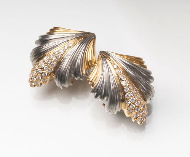 A pair of leaf shaped earclips with diamonds