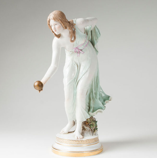 A porcelain figure 'tall female ball player'
