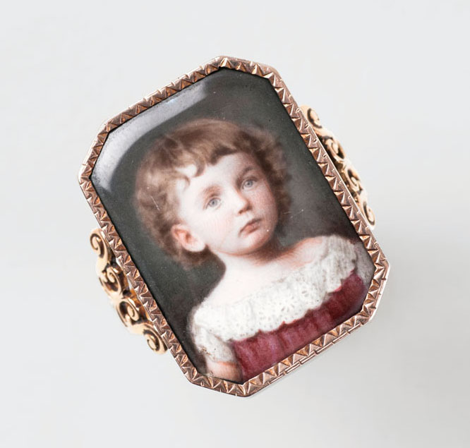 A gold ring with a miniature portrait