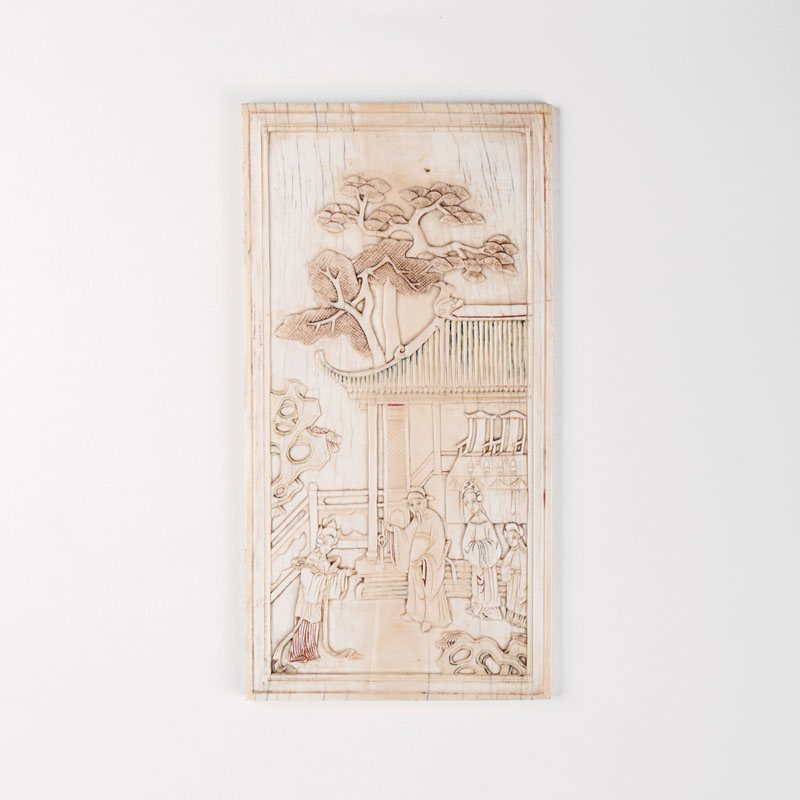 An ivory relief with garden scene