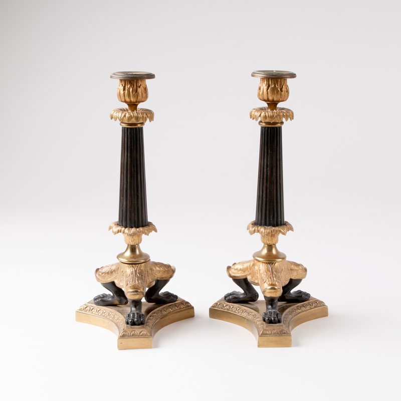 A pair of decorative candlesticks in the style of Charles X