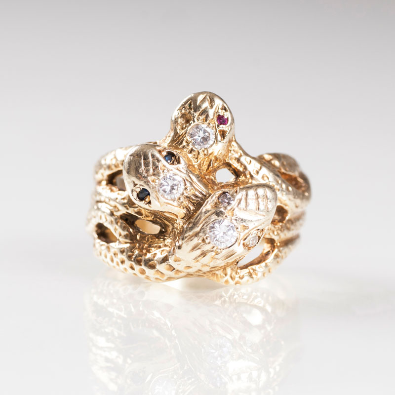 A golden ring with diamonds 'Snakes'