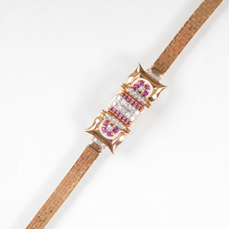 A Vintage ladie's wristwatch with diamonds and rubies by Bulova