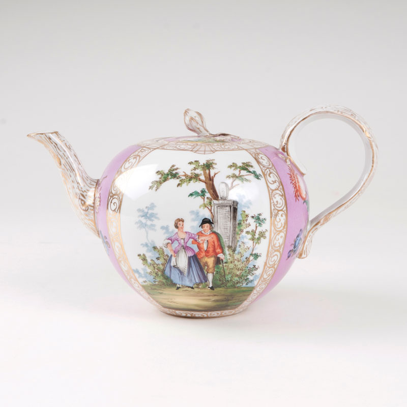 A teapot with scenes from Watteau