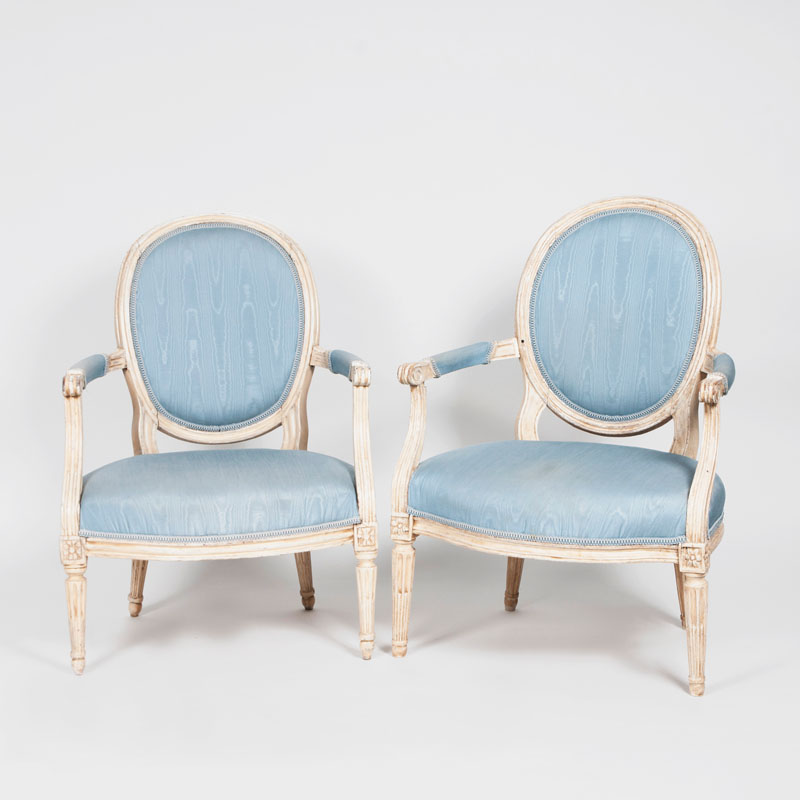 A pair of painted louis-seize-armchairs
