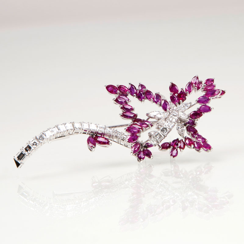 A highcarat flower brooch with diamonds and rubies