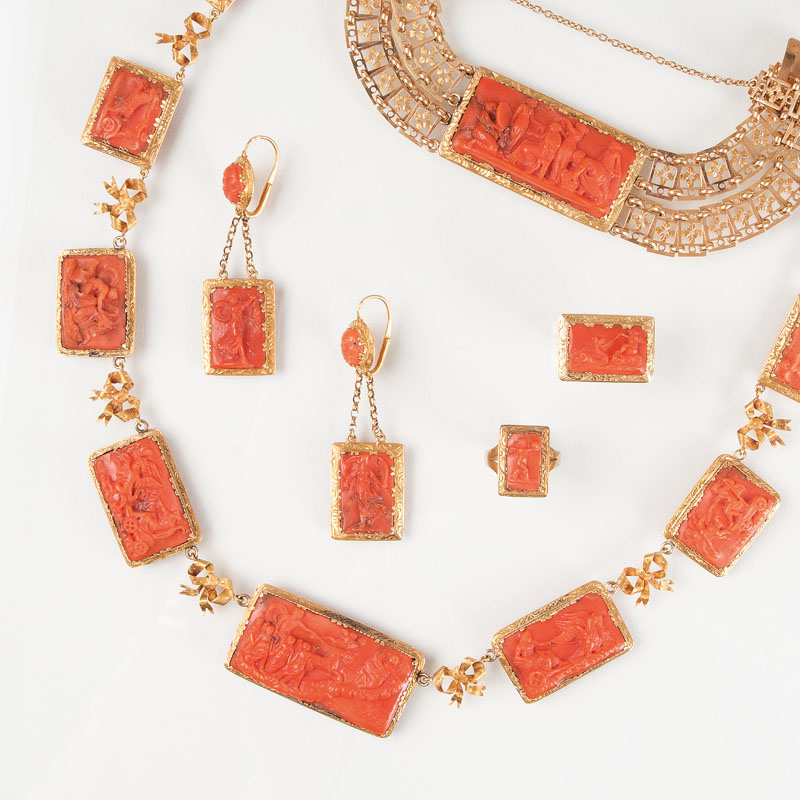 A rare antique coral parure with mythological scenes