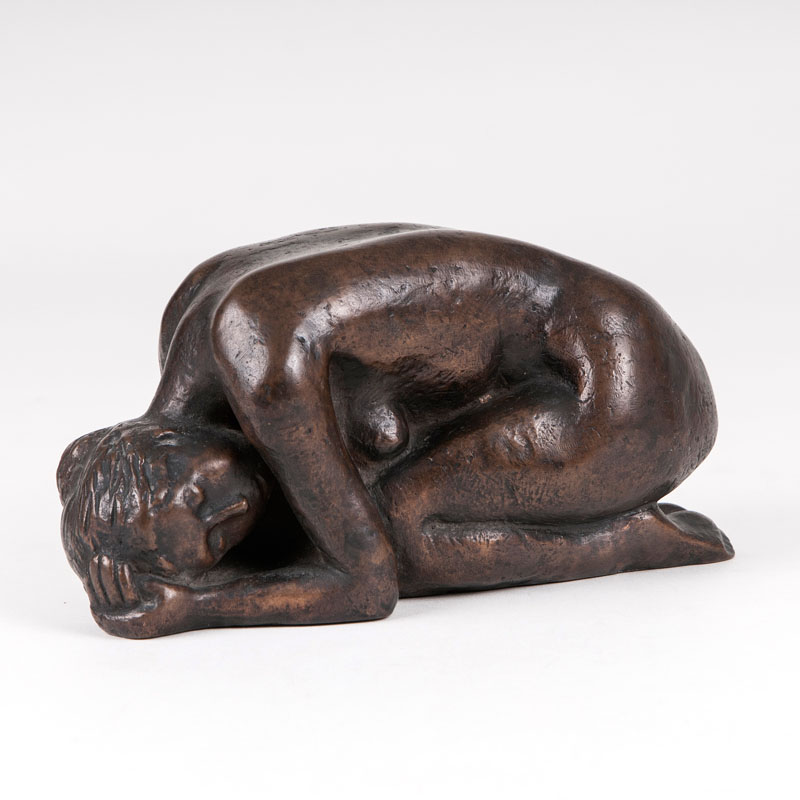A bronze sculpture 'a squatting female nude'