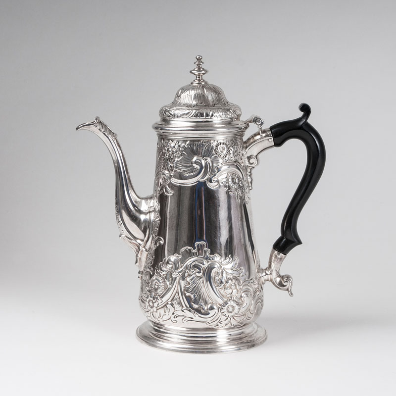 An early georgian Tea pot with rocaille decor