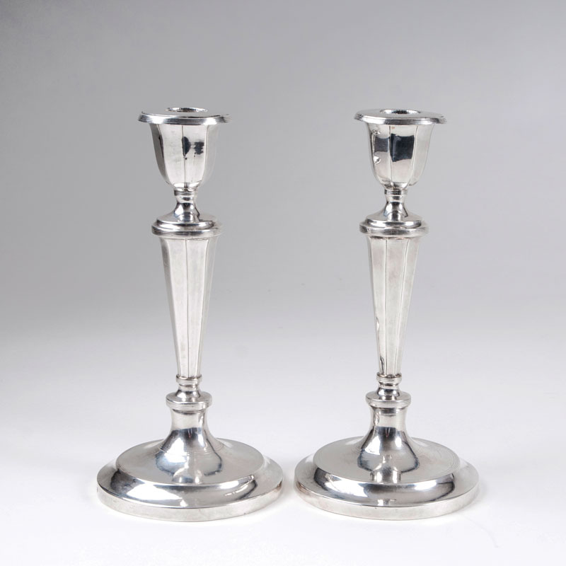 A pair of russian Empire table candle holders