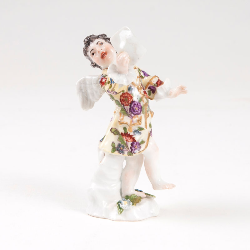 A porcelain figure 'Small disguised amoretto with sheet music'