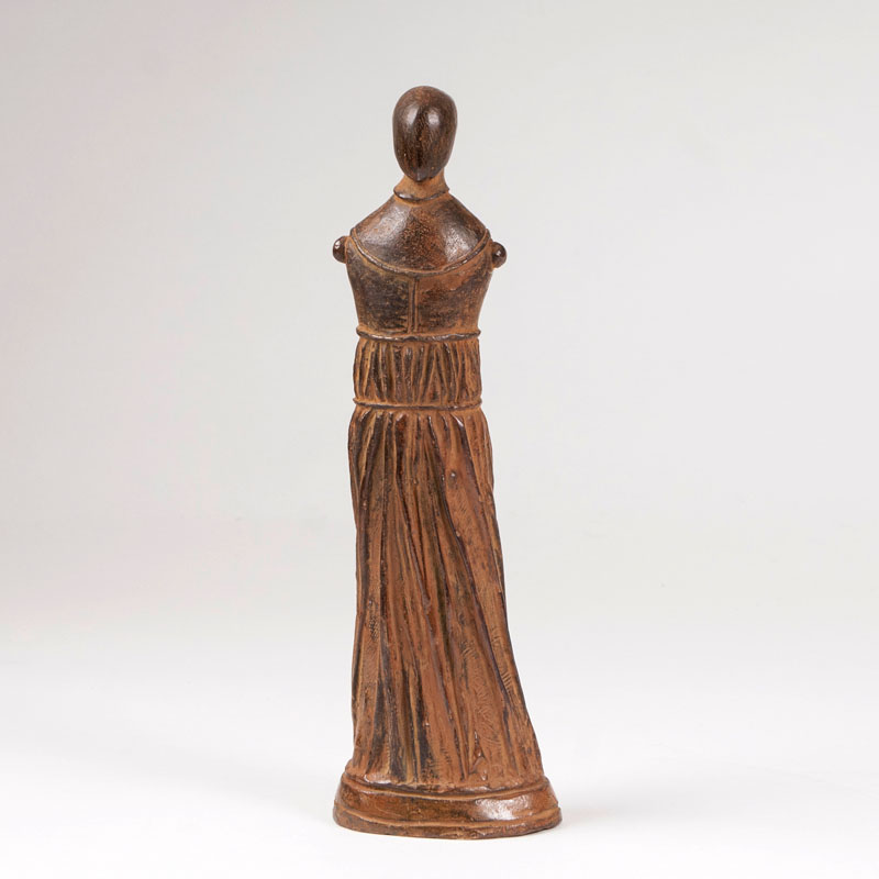 A bronze sculpture 'small draped figure, standing'