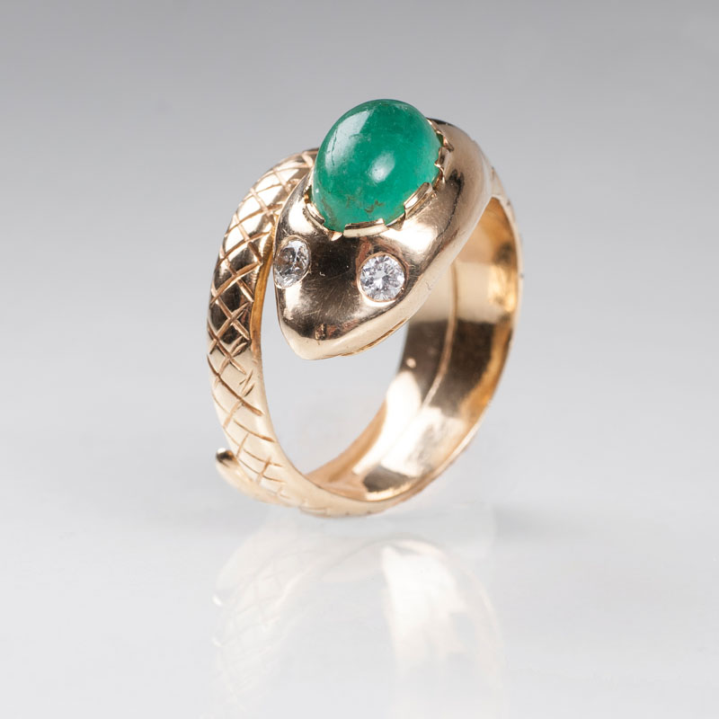 A golden ring 'Snake' with emerald and diamonds