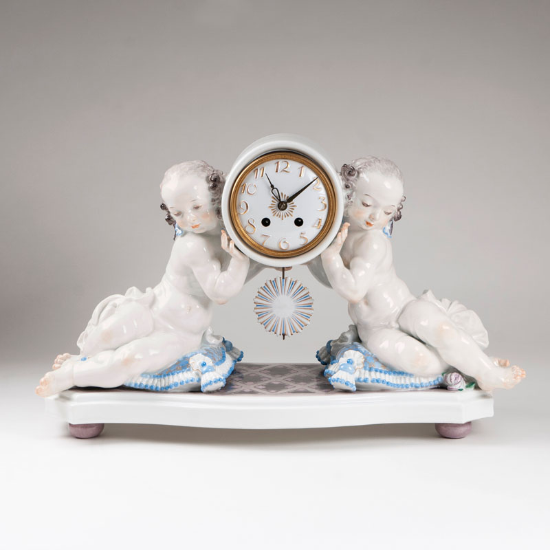 A large porcelain clock with a pair of putti